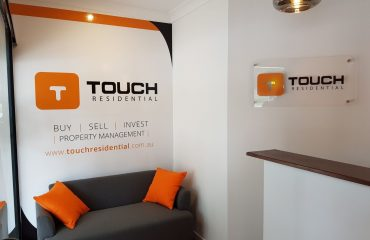 Custom Designed Wallpaper Signage